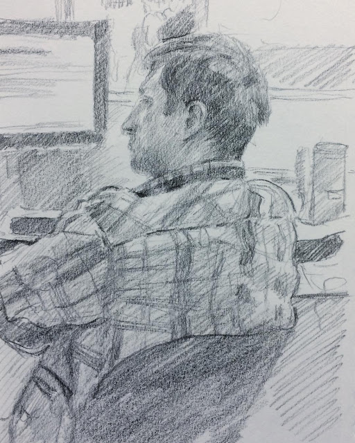Pencil sketch of Erik working at computer over lunch