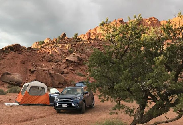 2019 Toyota Highlander Hybrid Limited Platinum AWD with tent