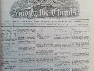 "A newspaper with the header ""Among the Clouds."""