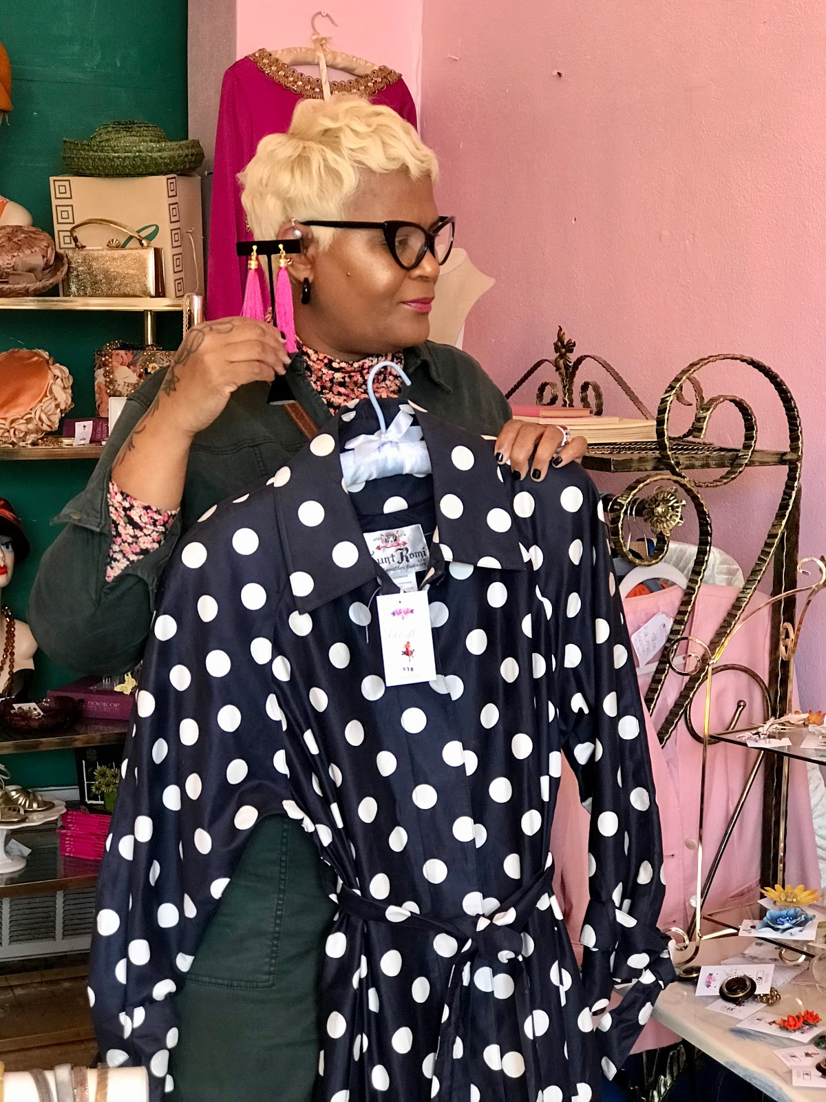 Tangie Bell went thriting and tried on polka dot dresses and pink earrings