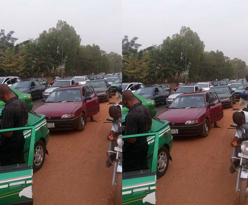 Photos: Abuja residents stranded for 1 hour because of Buhari's convoy - Driver