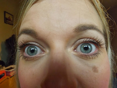 woman eyes open with big lashes