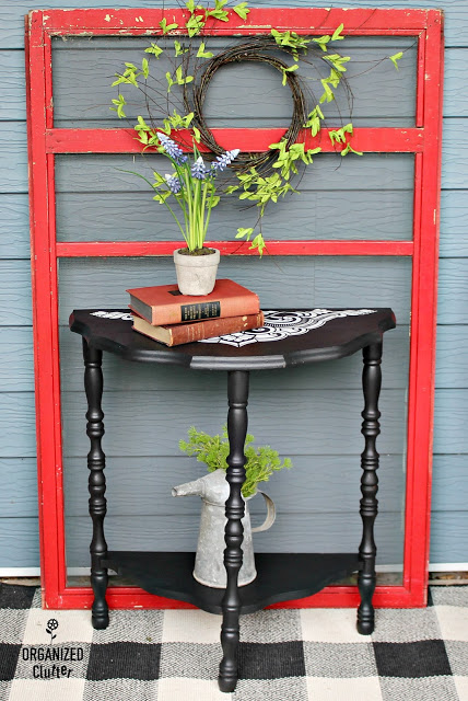 Photo of demilune table in black with stencils