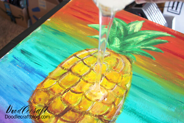 Next, pour the mixed resin on the center of the canvas. Use a clean stirring stick to gently smooth the resin close to all the edges. Some run-off may occur.