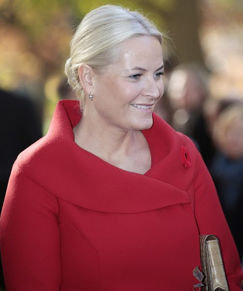 Crown Princess Mette-Marit wore Alexander Mcqueen Dress Coat, Gianvito Rossi pumps, clutch bag, pearl gold earrings