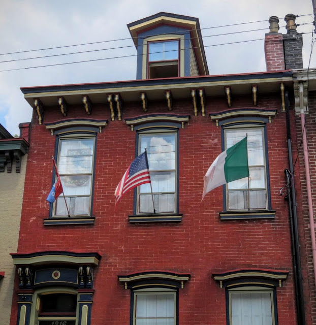 Building flying both American and Irish flags in the Mexican War Streets neighborhood of Pittsburgh