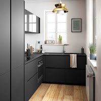 Black kitchen cabinet countertop for narrow kitchen ideas with wooden floor and great brass pendant light