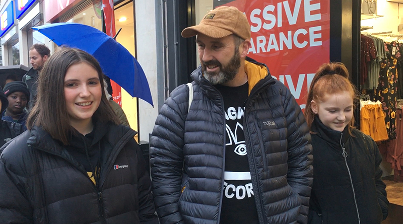 Dad Ian and daughters Mazie and Emily as they wait in-line for Stormzy outside HMV's Broadmead store in Bristol