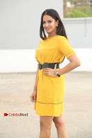 Actress Poojitha Stills in Yellow Short Dress at Darshakudu Movie Teaser Launch .COM 0049.JPG