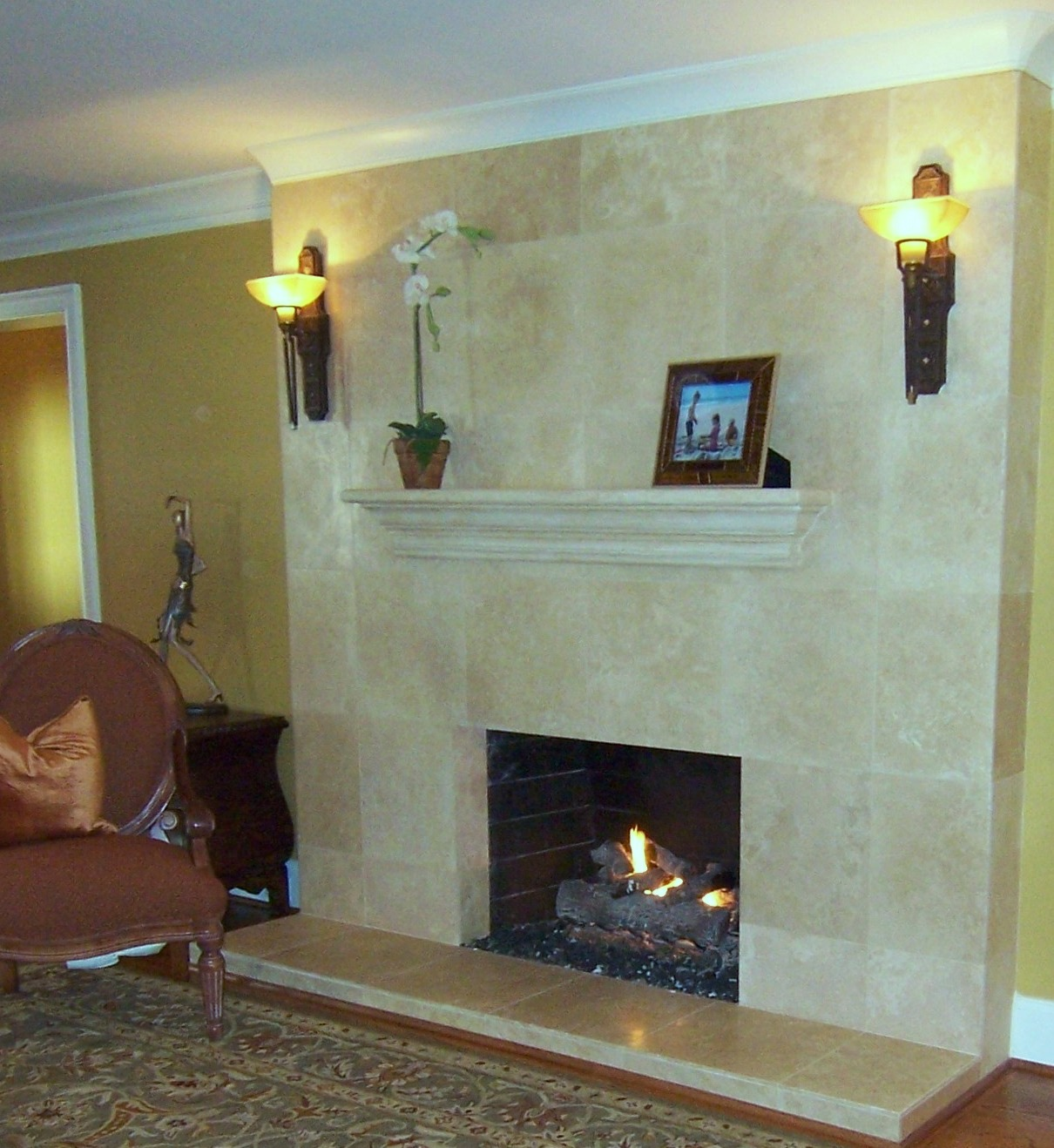 This Homeowner Preferred To Reface Their Brick Fireplace We Installed Limestone Tiles From Floor Ceiling Make The 8 Ceilings Feel Taller