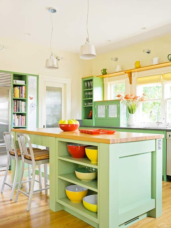 Love the bright green paint on these open kitchen cabinets!