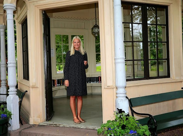 Crown Princess Mette Marit of Norway attended a event. wore Valentino print floral dress