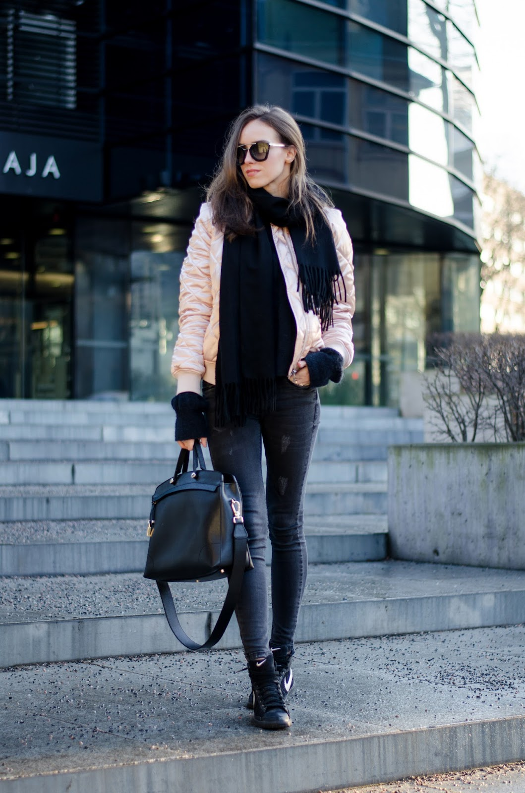 kristjaana mere pink bomber jacket black jeans winter outfit