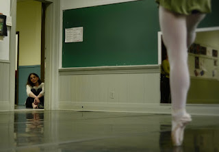 Tina Oates-Johnson watches her daughter rehearse ballet.