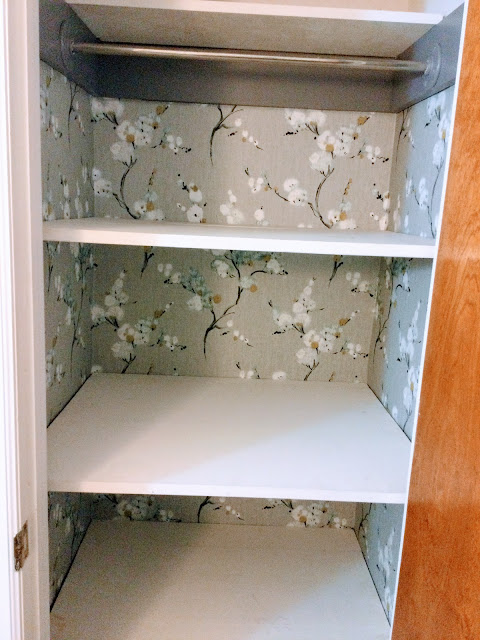 How our closet was made over using wallpaper