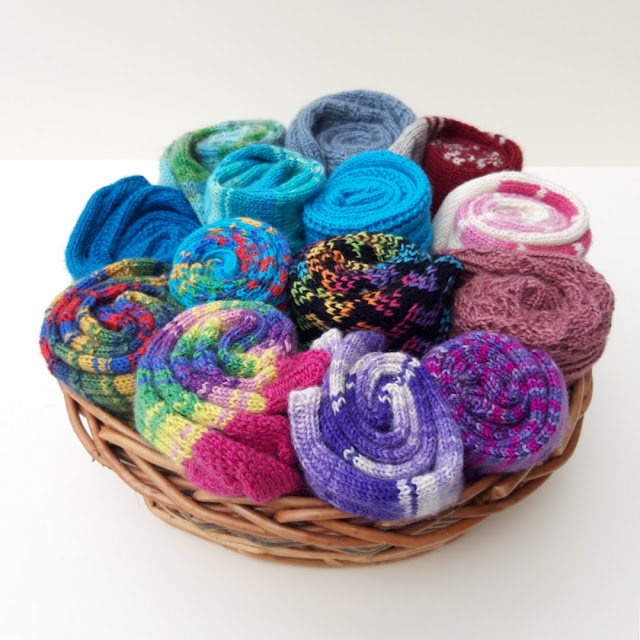 A basket of multi-coloured hand knitted socks