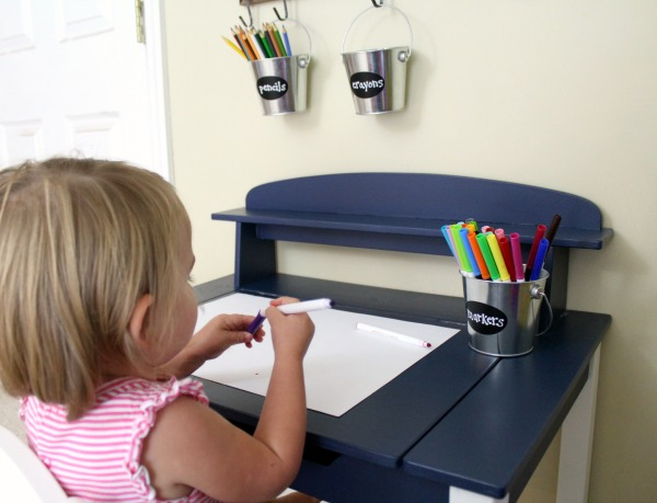 Organized art station for kid's art and craft supplies: Use metal buckets for easy supply storage