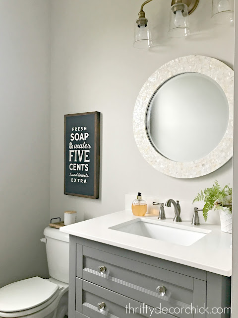 gray vanity with shelf powder room