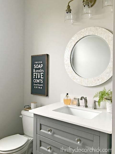 gray vanity with shelf powder room