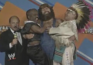 WWF / WWE WRESTLEMANIA 3 - Hillbilly Jim holds up Haiti Kid & Little Beaver like they're his kids