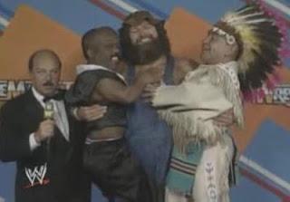 WWF / WWE WRESTLEMANIA 3 - Hillbilly Jim holds up Haiti Kid & Little Beaver like they're his kids