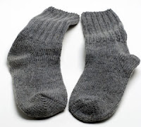 Image of a pair of old socks used for exercising.