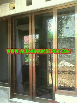 Kusen dan pintu aluminium ykk