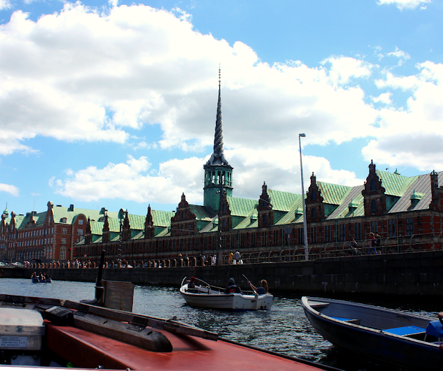 Børsen the Old Stock Exchange constructed in the 1600s in Copenhagen, Denmark as seen from the canal.