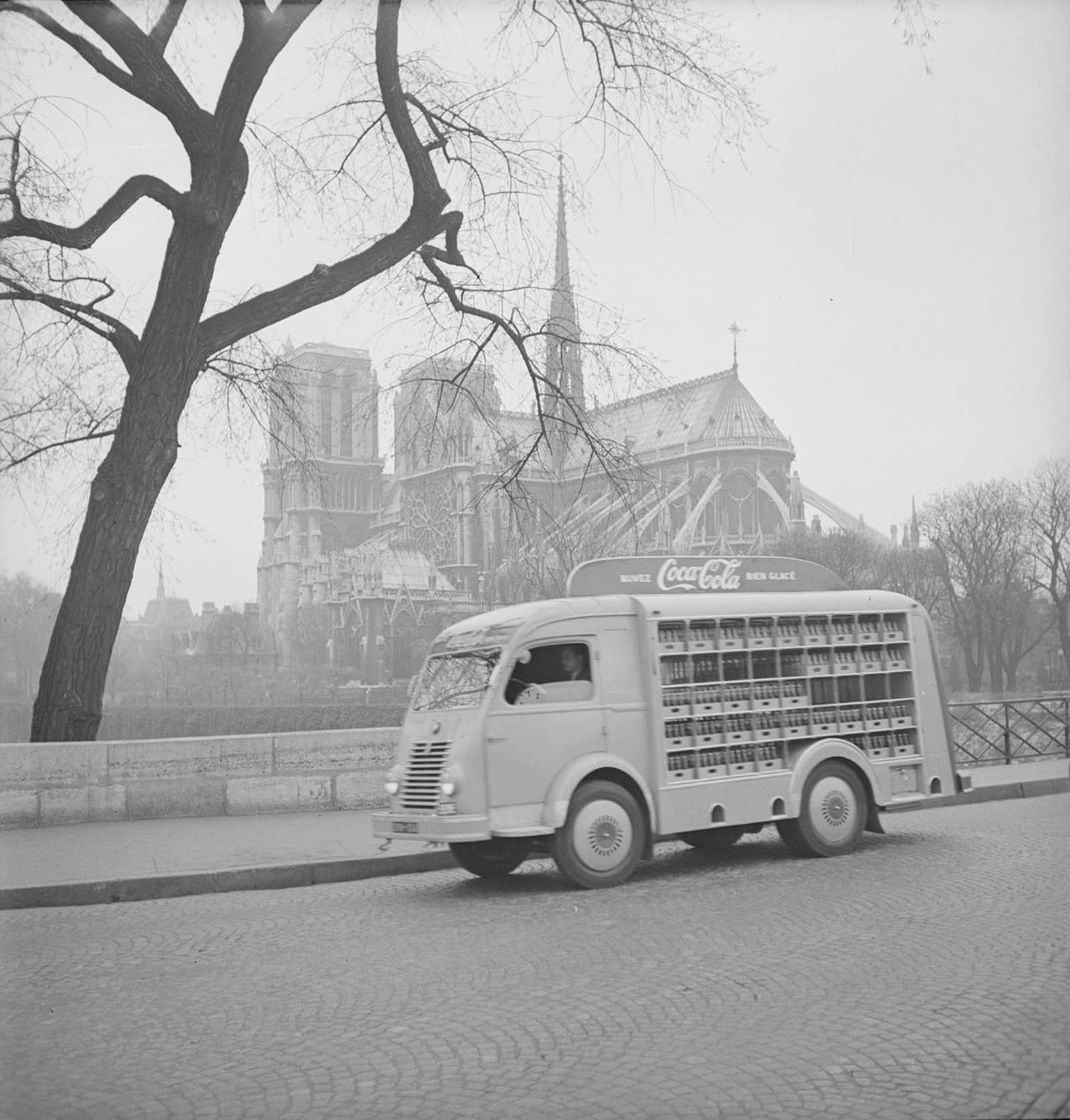 View of a Coca-Cola delivery truck as it crosses Pont de l'Archeveche, near the cathedral Notre Dame de Paris.