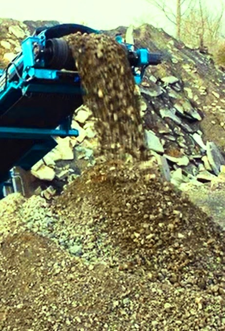 Rock crusher dust while producing concrete aggregate