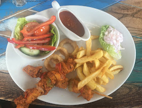 Lemon peri-peri chicken skewers with chips and side salad