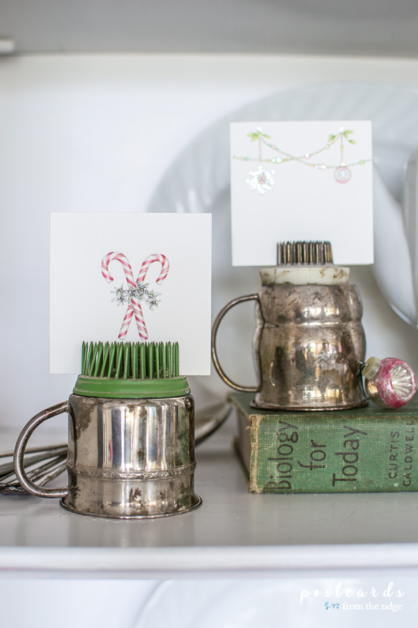 metal flower frogs and silver baby cups repurposed as tiny art easels