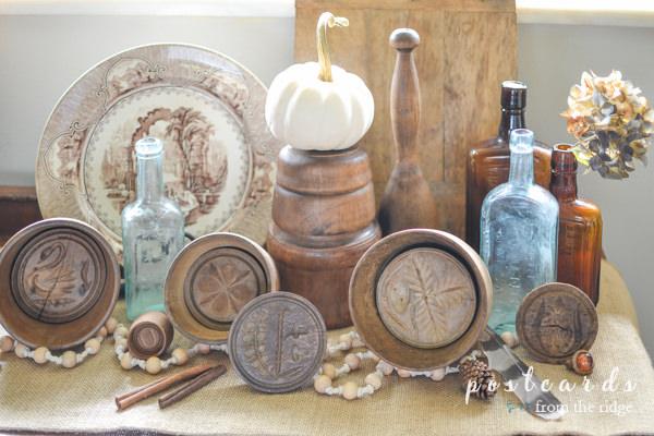 vintage wooden butter molds, glass bottles, dish