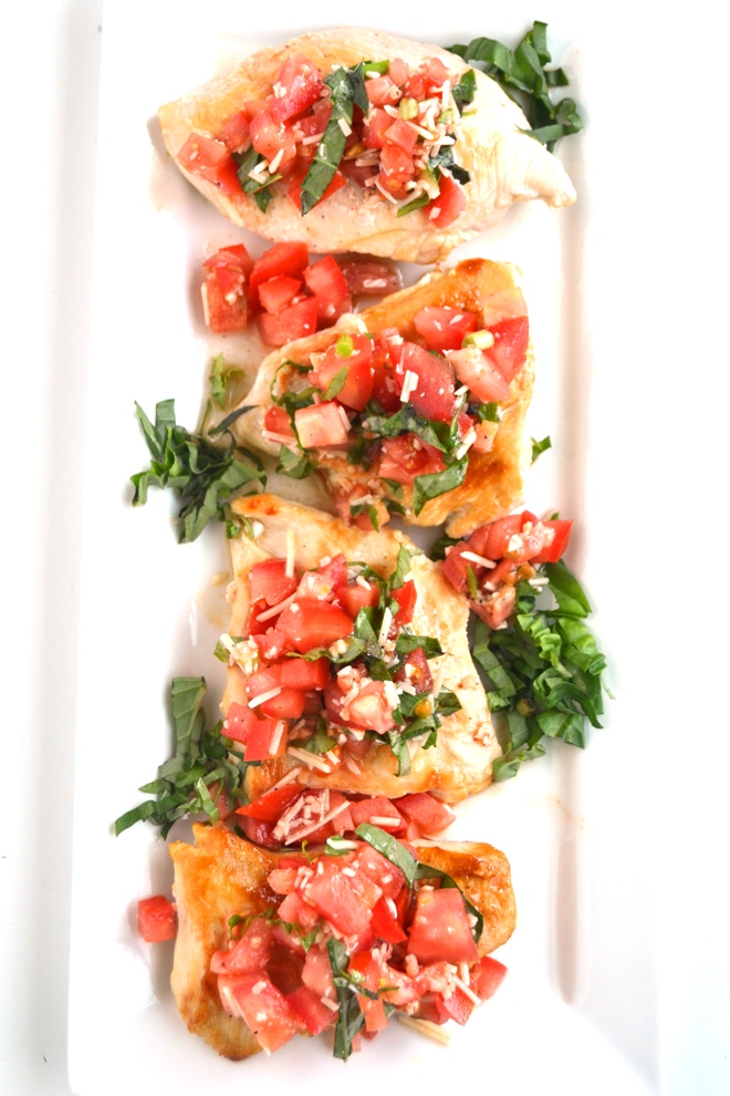 Bruschetta Chicken is ready in just 20 minutes and is the perfect fresh and flavorful recipe with tomatoes, garlic, Parmesan cheese and basil! www.nutritionistreviews.com