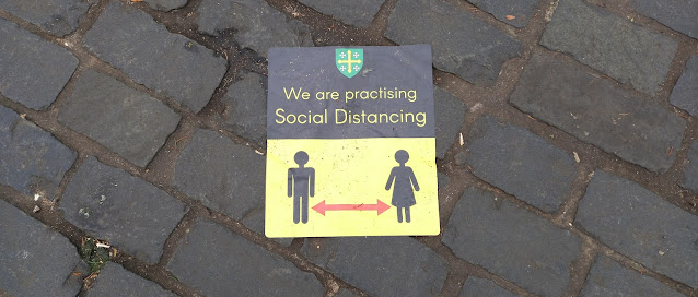 Covid-19 social distancing sign in Abingdon Market Place