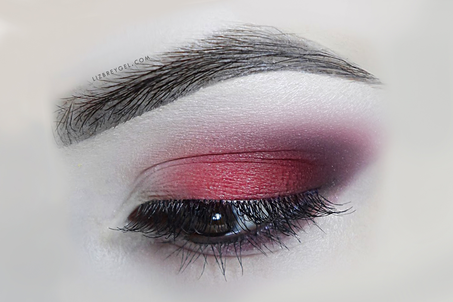 a clos eup picture of an eye with smoky makeup
