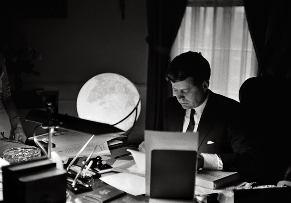President John F. Kennedy at work in the Oval office in 1962.