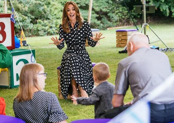 Kate Middleton is wearing a pleated polka-dot crepe shirtdress by Emilia Wickstead, and carina canvas wedge espadrilles from Castaner
