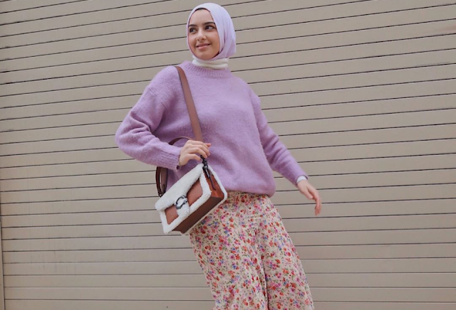 Give a touch of preppy chic with a lilac sweater and printed skirt