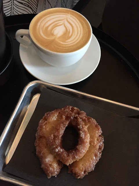 Bourbon Vanilla Latte and donut at Tala Coffee Roasters
