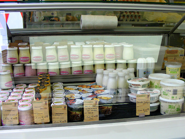 Creams and yoghurts on a cheese stall at Loches market. Indre et Loire. France. Photo by Loire Valley Time Travel.