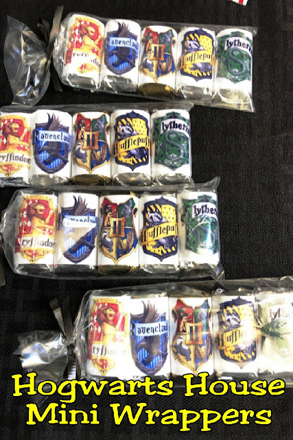 Celebrate the houses of Hogwarts coming together with this yummy Hogwarts Houses mini candy bars.  Whether you wrap them together or serve the individually, these printable candy bar wrappers are the perfect addition to your Harry Potter party.  #harrypotterparty #hogwartshouses #candybarwrapper #diypartymomblog