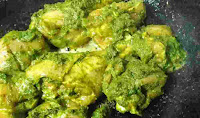 Cooking chicken green color chicken pieces for chicken cafreal recipe