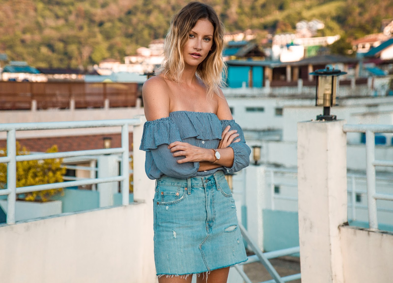 fashion and travel blogger, Alison Hutchinson, in Phuket Thailand, wearing a Faithfull the Brand off the shoulder top and Levi's deconstructed denim skirt