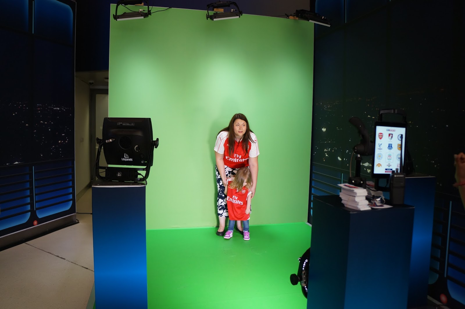 mother and daughter taking a picture in front of green screen at the sky studios at the o2