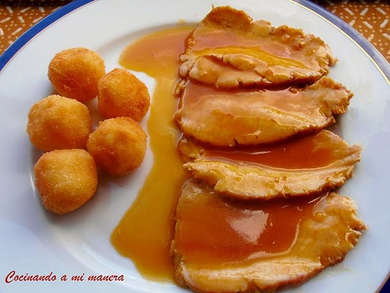 Cinta de lomo en salsa de naranja