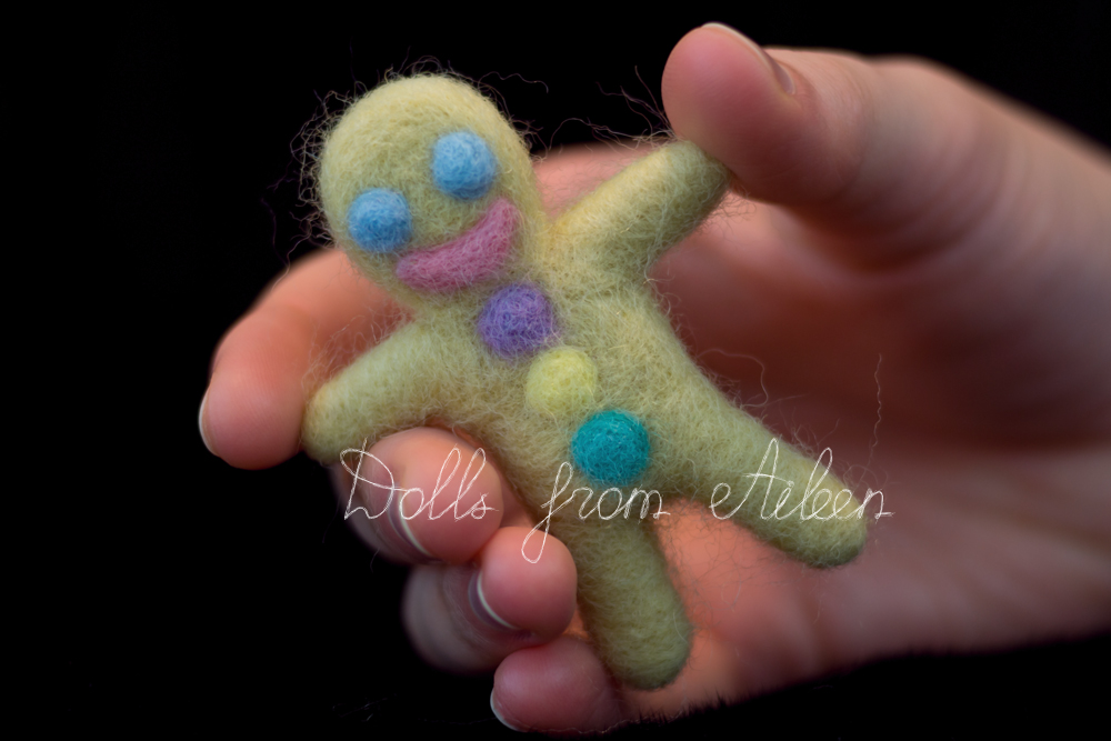 human hand holding OOAK needle felted gingerbread man
