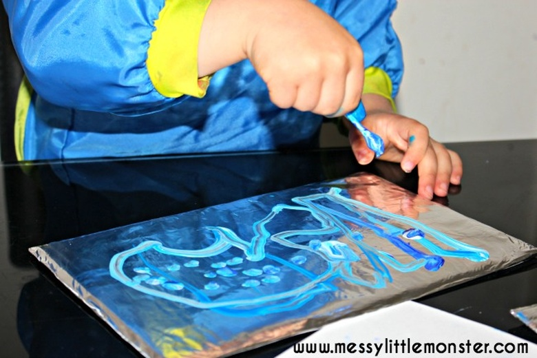 Painting on foil snow craft for kids