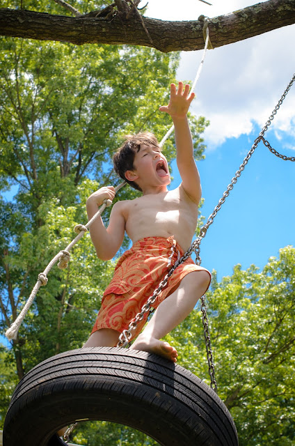 boy on tire swing ©Diana Sherblom Photography