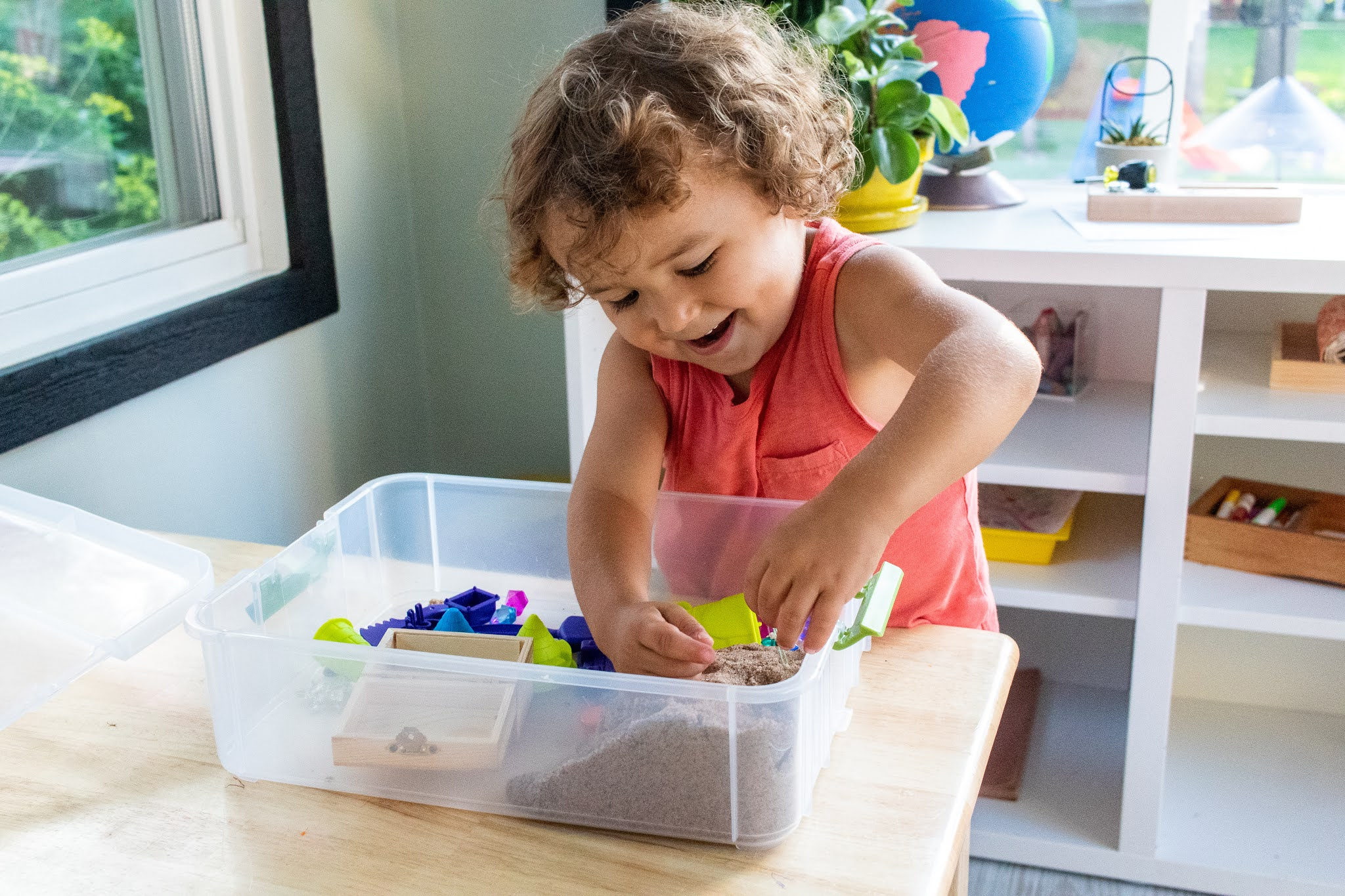 Montessori preschool activities for helping your child get more used to texture. This helps prepare their hand for sandpaper letters and other fun!